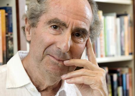FILE - In this Sept. 8, 2008, file photo, author Philip Roth poses for a photo in the offices of his publisher, Houghton Mifflin, in New York. Roth, prize-winning novelist and fearless narrator of sex, religion and mortality, has died at age 85, his literary agent said Tuesday, May 22, 2018. (ANSA/AP Photo/Richard Drew, File) [CopyrightNotice: Copyright 2018 The Associated Press. All rights reserved.]